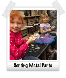 Molly and Madeline sorting metal